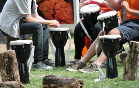 bongo drum: Bongo musicians drumming circle drums and seats - Stock Photo