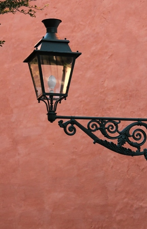 old cast iron street wall lamp photo