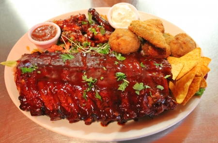 ribs platter BBQ ribs and wings platter with nachos  photo