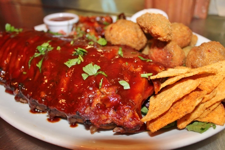 BBQ ribs and wings platter with nachos  Banco de Imagens