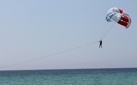 towed: Paraglider parashute over sea towed
