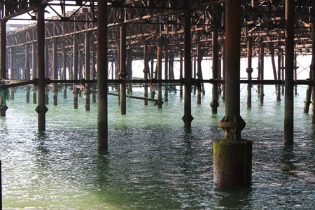 hastings: Hastings Pier from underneth shown after fire