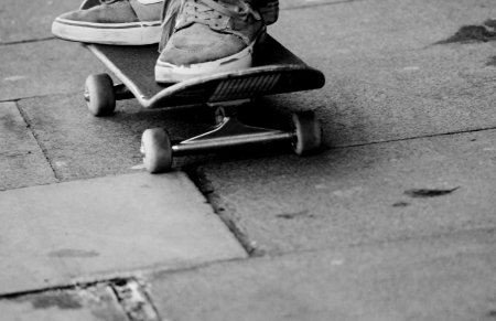 skateboard teen at skate park with board