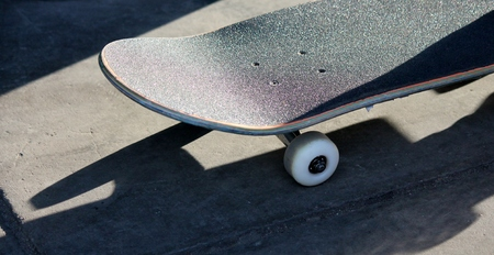 lone skateboard in skate park  - Stock Photo photo