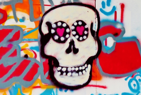 candy skull graffiti wall deralict building london