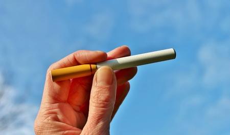 vapour: electronic battery powered vapour e-cigarettes against sky Stock Photo
