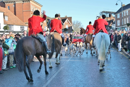 Huntsman ready for the fox hunt on horse with crowd\