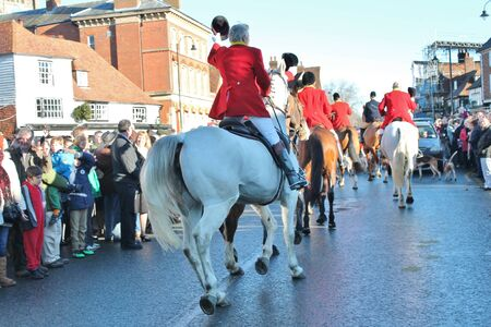 Huntsman ready for the fox hunt on horse with crowd
