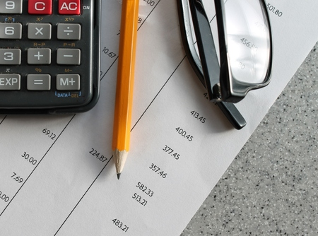 Bank statement with pencil and calculator photo
