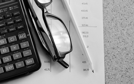accounting tax Bank statement with pencil and calculator photo