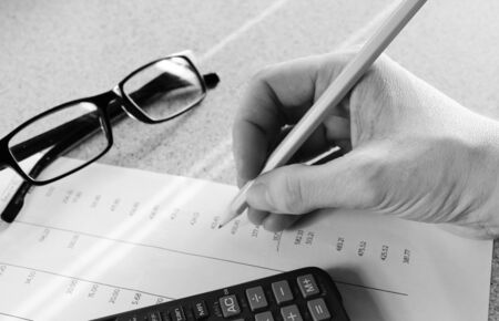 accounting Bank statement with pencil and calculator Stock Photo - 26037192