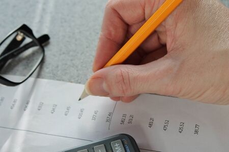 accounting Bank statement with pencil and calculator photo