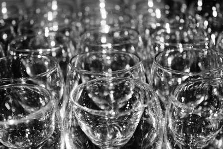 rows of empty wine glasses photo