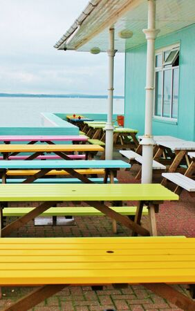 cafe seaside tables outside with sea photo
