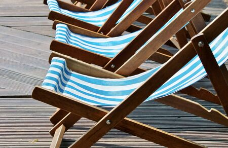 row of stripy deck chairs on a promanade