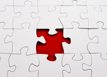 blank jigsaw puzzle missing piece in red photo