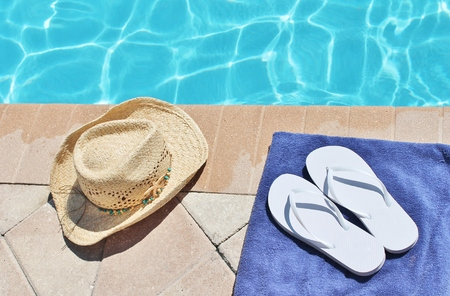 Poolside holiday scenic cowboy hat poolsummer Stock Photo