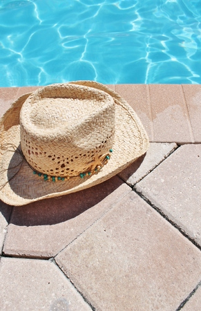 sandels: Poolside holiday scenic cowboy hat poolsummer Stock Photo
