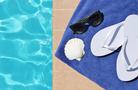 sandels: Poolside holiday vacation scenic swimming pool summer Stock Photo