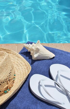 sandels: Poolside holiday scenic towel, hat, shell,