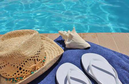 Poolside holiday scenic towel, hat, shell,