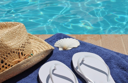 Poolside holiday scenic towel, hat, shell,  photo