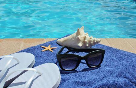 sandels: Swimming pool sunglasses towel and shell sandels flip flops