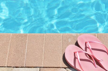 Poolside holiday vacation scenic swimming pool summer sandels shoes photo