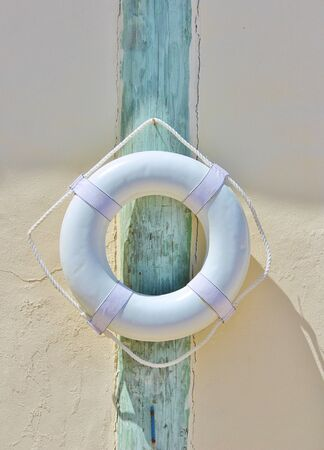 Life preserver belt buoy by swimming pool Banco de Imagens
