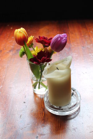 candle table flowers photo
