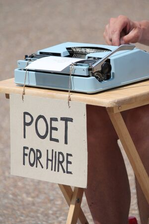 manful: Poet for hire with typewriter Stock Photo