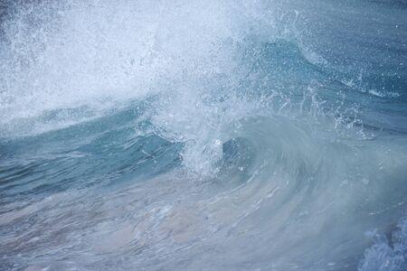 shorebreak: Ocean surf Wave Barrell curling before crashing Stock Photo