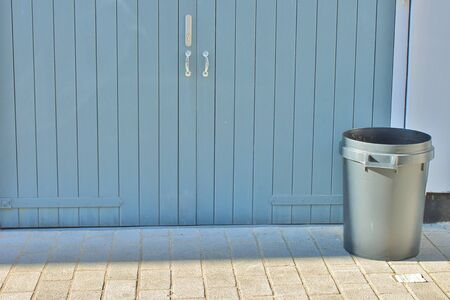 Dustbins outside against wall photo