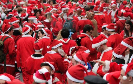 fancy dress party: Santa day in London when a giant pub crawl party through London giving out sweets and singing