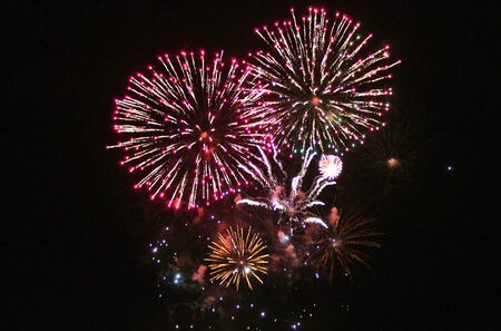 Firework display cluster explosions Stock Photo