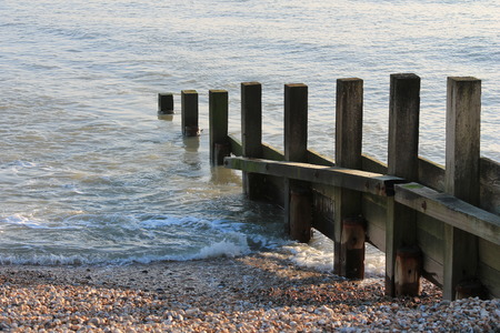 seawall: Old groin water breaker sea wall Stock Photo