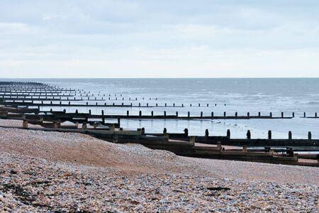 seawall: wooden groynes water breaker breaks at the beach