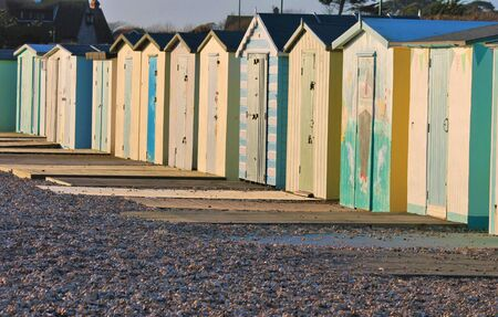 hut: Traditional British beach huts at Uk seaside Brightly coloured beach huts on the front at Bognor Regis, Sussex, England