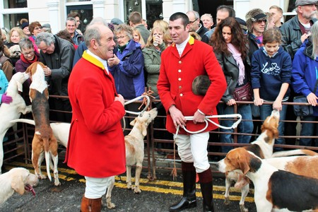 FOX HUNT, TENTERDEN, KENT, ENGLAND, UK- DEC 26TH 2015: Fox hunt Annual Boxing day meet in high street hounds in pen with hunt master