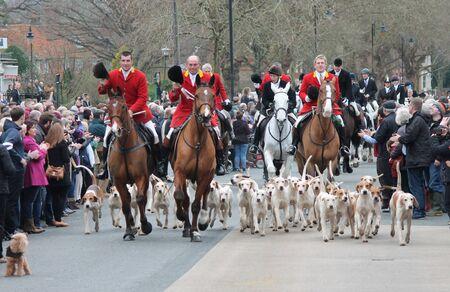 fox hunt start hounds horses running up road