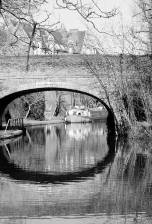 inland waterways: canal barge on canal river- Regents Canal, London