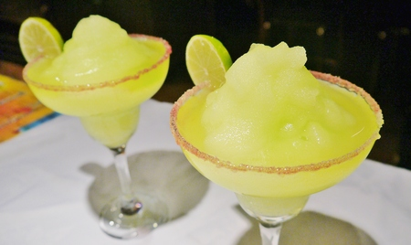 Frozen maragrita cocktail Mexican tequila drink salt rim lime wedge