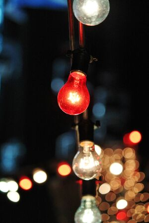 string lights: Decorative outdoor string lights hanging at night time fairy Stock Photo