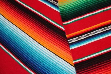 Mexico poncho serape traditional cinco de mayo fiesta background with stripes copy space