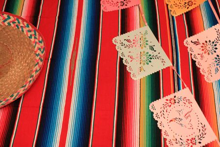 Mexico poncho sombrero skull background fiesta cinco de mayo decoration bunting flags Stock Photo