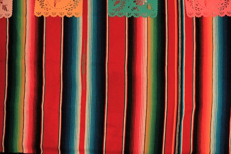 Mexico poncho sombrero background fiesta cinco de mayo decoration bunting flags Stock Photo