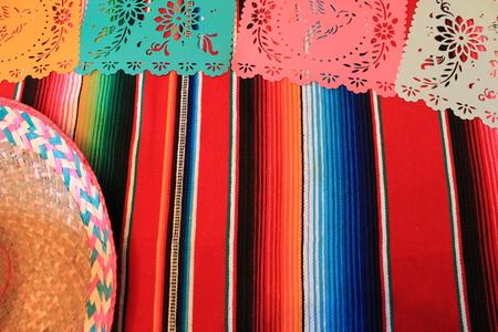 fiesta cinco de mayo decoration bunting papel picado flags Mexico poncho sombrero background Stock Photo
