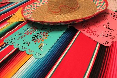 Mexico poncho sombrero background fiesta cinco de mayo decoration bunting flags Stock Photo