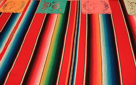 Mexico poncho sombrero skull background fiesta cinco de mayo decoration bunting flags Stock Photo