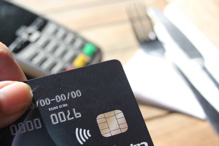 contactless payment card pdq background copy space with hand holding credit card ready to pay Stock Photo